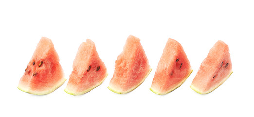 Lined up watermelon pieces isolated