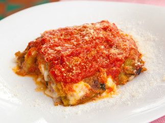 Parmigiana, Italian food with eggplant, tomato and cheese.