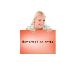 Composite image of smiling woman standing behind a whiteboard