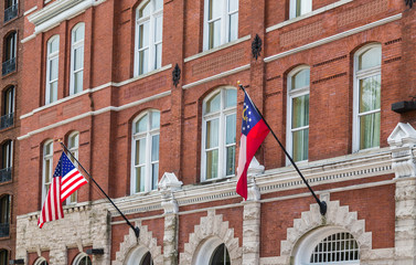 American and Georgia flags on Old Brick Building