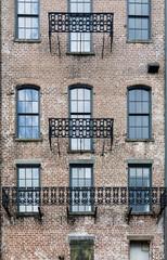 Black Iron Trim on Windows of Old Brick Building