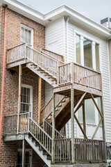 New Wood Steps Outside Old Wood and Brick Homes