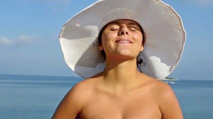 Girl sunbathing and smiling at camera