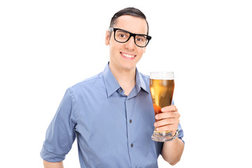 Cheerful young guy holding a pint of beer