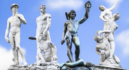 Perseus holding head of Medusa,.Michelangelo's David,.Hercules a