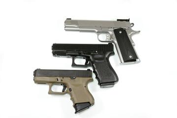 three pistols on white background