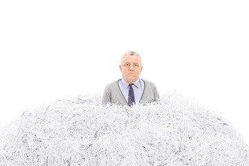 Senior trapped in a pile of shredded paper