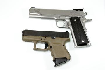 Automatic handgun on white background.