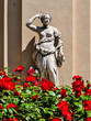 Statue and red flowers