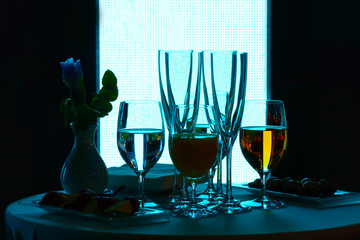 Glasses with wine and water
