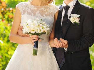Groom Embracing Wife