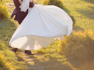 Groom Whirling Bride