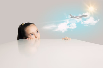 Girl and airplane in sky