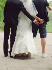Newlyweds and Groomsman Having Fun