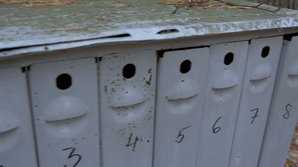 A big mailbox with eight small holes