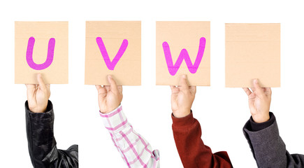 Placard with alphabets from U to W  in magenta color
