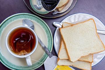 Tea with toast on table
