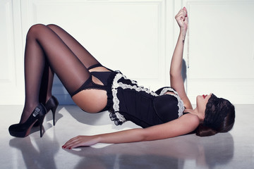 Sexy woman in corset laying on floor
