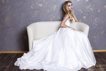 beautiful bride with blond hair in luxurious dress