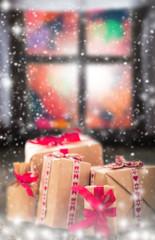 Christmas gifts rustic table window dark snowing