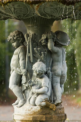 Ornamental fountain with figures of children in the garden
