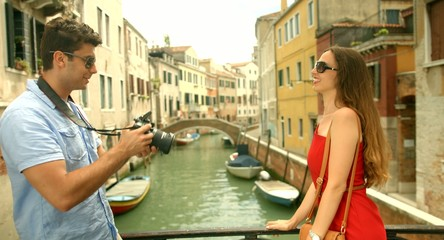 Man taking Pictures of Beautiful Woman in Italy Tourism Travel