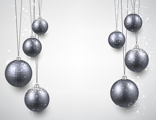 Paper background with silver christmas baubles.
