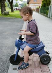 Child riding toy bike