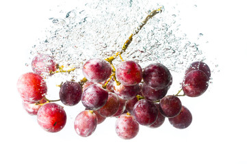 grape fruits fall deeply under water