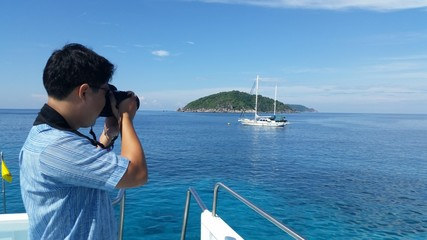 Photographer take a photo of boat
