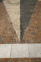 near mozzate street   varese abstract   pavement of a curch  wal