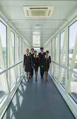 Italy, Sardinia, Olbia Airport, flight assistants in a Finger