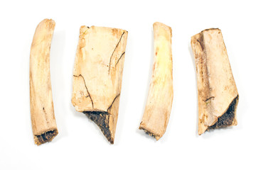 Four pieces of beef rib bones isolated on white