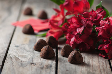 Concept of Valentine with truffles and red flowers
