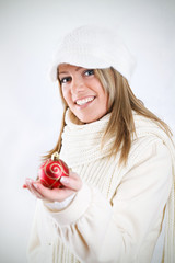 Young woman showing christmas decoration