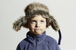 funny child in fur Hat.fashion casual winter style.little boy