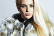 Beautiful blond woman in fur.winter Beauty blond Model Girl