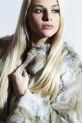Fashion Blond Girl in Fur Coat.Beautiful Winter Woman.rabbit fur