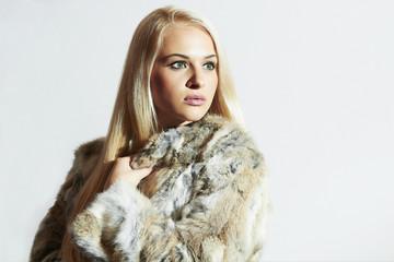 Beautiful woman in fur.winter blond Girl in Rabbit Fur Coat