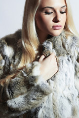 Beautiful blond woman in fur.winter.Girl in Luxury Fur Jacket