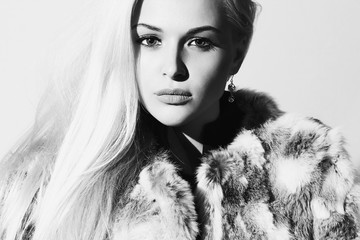 monochrome portrait of Beautiful blond woman in fur.winter
