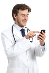Happy doctor man texting on a smart phone