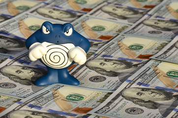 Toy creature with helix and dollars (inflation, savings, collaps