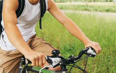 Cyclist man holding handlebar of mountain bike