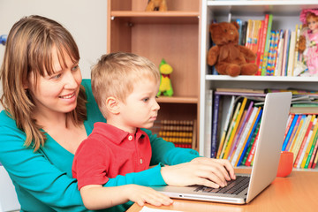 mother working from home with little son