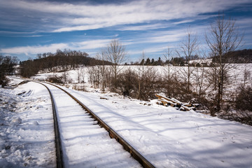 Snow covered railroad tracks in rural Carroll County, Maryland.