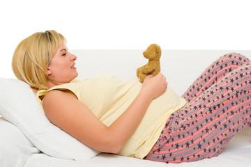 happy pregnant woman on sofa