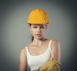 Female architect career beginner standing in helmet and gloves