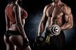 Leinwanddruck Bild - Closeup of a muscular young man lifting weights
