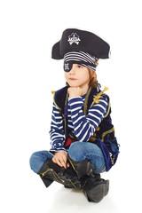 Grinning little boy pirate